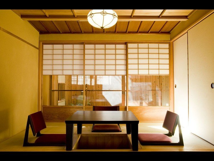 Tatami living room with horikatsu and table, adjacent to garden.